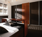 fitted-sliding-wardrobe-dark-wood-bedroom-doors