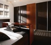 fitted-sliding-wardrobe-dark-wood-bedroom-doors